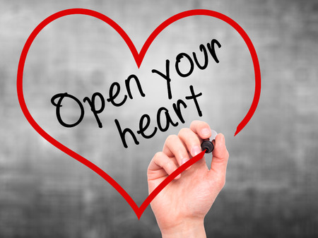 open your heart: Man Hand writing Open your heart with marker on transparent wipe board. Isolated on grey. Health, charity, internet, technology concept.  Stock Photo Stock Photo