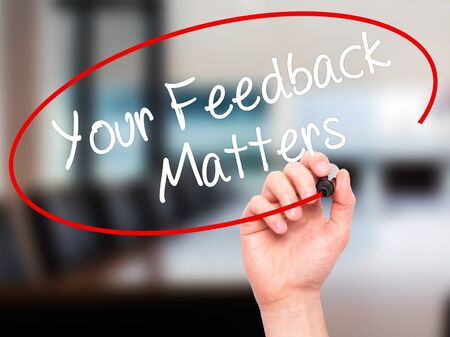 solicit: Man Hand writing Your Feedback Matters with black marker on visual screen. Isolated on office. Business, technology, internet concept. Stock Photo