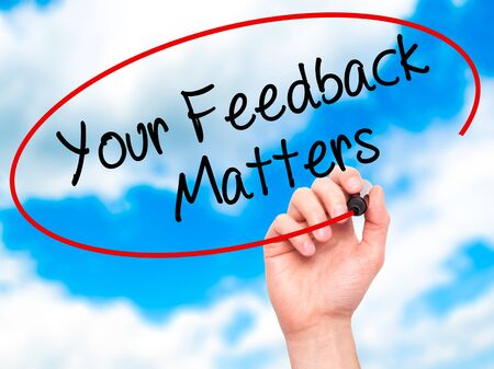 Man Hand writing Your Feedback Matters with black marker on visual screen. Isolated on sky. Business, technology, internet concept. Stock Photo Stock Photo