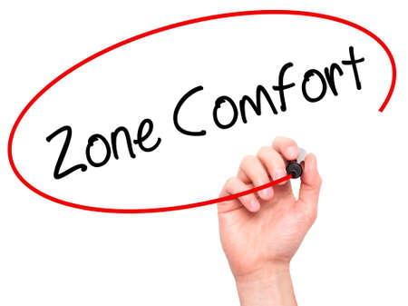 quo: Man Hand writing Zone Comfort with black marker on visual screen. Isolated on white. Business,  internet concept. Stock Photo Stock Photo