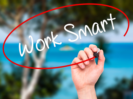 inteligent: Man Hand writing Work Smart with black marker on visual screen. Isolated on nature. Business, technology, internet concept. Stock Photo