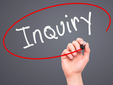 inquiry: Man Hand writing Inquiry with marker on transparent wipe board. Isolated on grey. Business, internet, technology concept.  Stock Photo