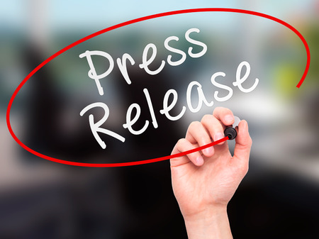 Man Hand writing Press Release with marker on transparent wipe board. Isolated on office. Business, internet, technology concept. Stock Photo Banque d'images