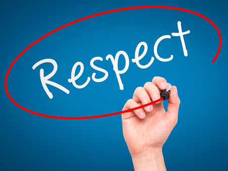 decent: Man Hand writing Respect black marker on visual screen. Isolated on blue. Business, technology, internet concept. Stock Image
