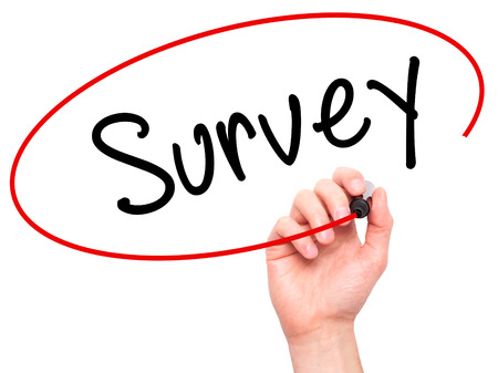 appraise: Man Hand writing Survey with marker on transparent wipe board isolated on white. Business, internet, technology concept. Stock Photo