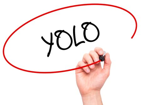 once person: Man Hand writing YOLO (You Only Live Once) with black marker on visual screen. Isolated on white. Business, technology, internet concept. Stock Photo