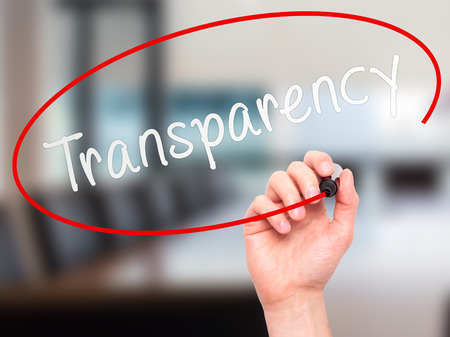 evident: Man Hand writing Transparency with marker on transparent wipe board. Isolated on office. Business, internet, technology concept.  Stock Photo