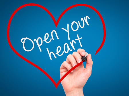 open your heart: Man Hand writing Open your heart with marker on transparent wipe board. Isolated on blue. Health, charity, internet, technology concept.  Stock Photo
