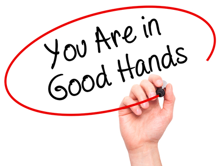 best ad: Man Hand writing You Are in Good Hands with black marker on visual screen. Isolated on white. Business, technology, internet concept. Stock Photo