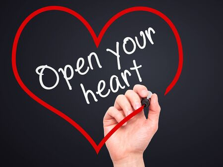open your heart: Man Hand writing Open your heart with marker on transparent wipe board. Isolated on black. Health, charity, internet, technology concept.  Stock Photo Stock Photo