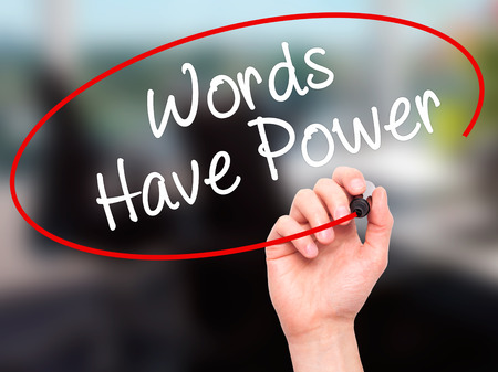 communicative: Man Hand writing Words Have Power with black marker on visual screen. Isolated on office. Business, technology, internet concept. Stock Photo