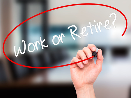 retire: Man Hand writing Work or Retire? with black marker on visual screen. Isolated on office. Business, technology, internet concept. Stock Photo Stock Photo