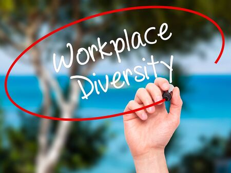 competitiveness: Man Hand writing Workplace Diversity  with black marker on visual screen. Isolated on background. Business, technology, internet concept. Stock Photo