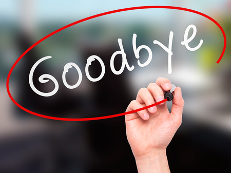 Man Hand writing Goodbye with marker on transparent wipe board. Isolated on office. Business, internet, technology concept. Stock Photo Reklamní fotografie