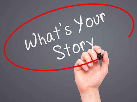 photo story: Man Hand writing Whats Your Story with marker on transparent wipe board. Isolated on grey. Business, internet, technology concept.  Stock Photo