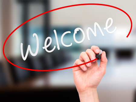usher: Man Hand writing Welcome with marker on transparent wipe board. Isolated on office. Business, internet, technology concept. Stock Photo Stock Photo