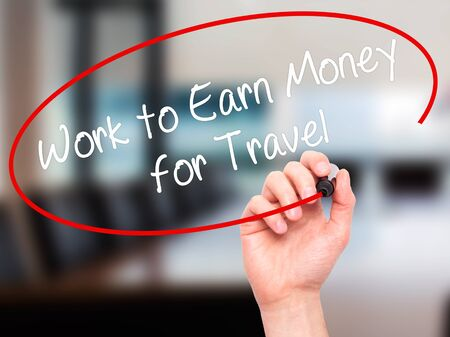 earn money: Man Hand writing Work to Earn Money for Travel with black marker on visual screen. Isolated on office. Business, technology, internet concept. Stock Photo