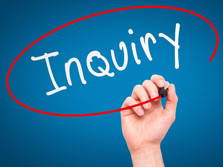 inquiry: Man Hand writing Inquiry with marker on transparent wipe board. Isolated on blue. Business, internet, technology concept.  Stock Photo
