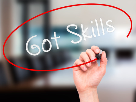 able to learn: Man hand writing Got Skills on visual screen. Business,help, internet, technology concept. Isolated on office. Stock Photo Stock Photo