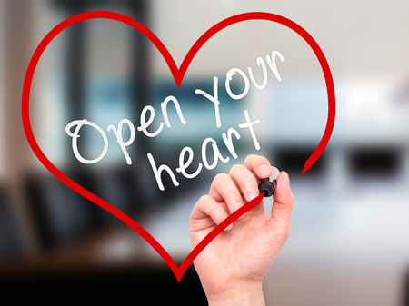 open your heart: Man Hand writing Open your heart with marker on transparent wipe board. Isolated on office. Health, charity, internet, technology concept.  Stock Photo