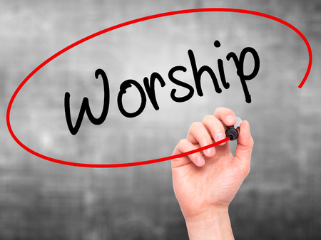 worshipper: Man Hand writing Worship with black marker on visual screen. Isolated on grey. Business, technology, internet concept. Stock Photo
