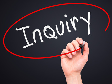 inquiry: Man Hand writing Inquiry with marker on transparent wipe board. Isolated on black. Business, internet, technology concept.  Stock Photo