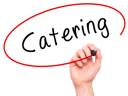 cuisine entertainment: Man Hand writing Catering with marker on transparent wipe board. Isolated on white. Business, internet, technology concept.  Stock Photo