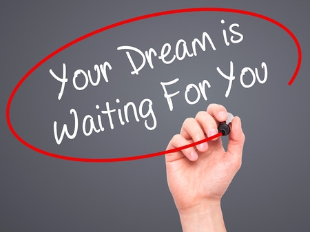 carrer: Man Hand writing Your Dream is Waiting For You with black marker on visual screen. Isolated on background. Business, technology, internet concept. Stock Photo Stock Photo