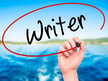 writer's block: Man Hand writing Writer with black marker on visual screen. Isolated on background. Business, technology, internet concept. Stock Photo