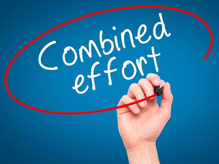 combined effort: Man Hand writing Combined effort with black marker on visual screen. Isolated on blue. Business, technology, internet concept. Stock Image Stock Photo
