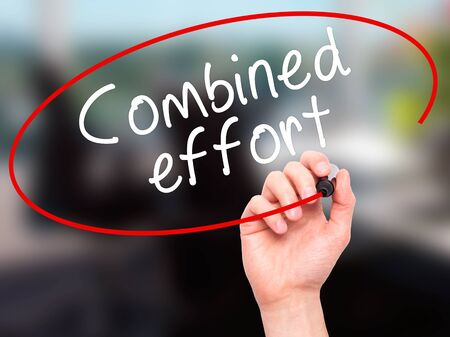 combined effort: Man Hand writing Combined effort with black marker on visual screen. Isolated on office. Business, technology, internet concept. Stock Image