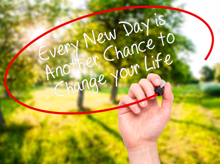 Man Hand writing Every New Day is Another Chance to Change your Life with black marker on visual screen. Isolated on nature. Business, technology, internet concept. Stock Photo Stock Photo