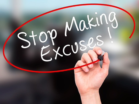 pardon: Man Hand writing Stop Making Excuses with black marker on visual screen. Isolated on office. Business, technology, internet concept. Stock Image