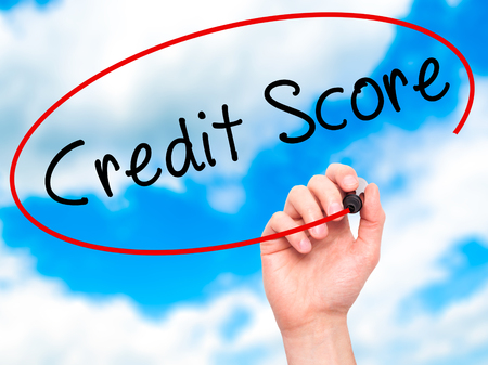 Man Hand writing Credit Score black marker on visual screen. Isolated on sky. Business, technology, internet concept. Stock Image