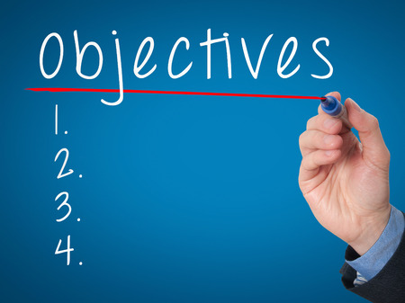 objectives: Man Hand writing Objectives to do list with marker. Business, internet concept. stock Image