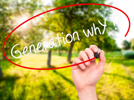 identidad cultural: Man Hand writing Generation whY !? with black marker on visual screen. Isolated on nature. Business, technology, internet concept. Stock Photo