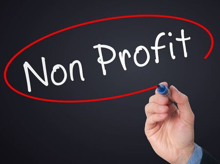 non stock: Man Hand writing Non Profit with marker on virtual screen. Business, technology, internet concept. Stock Photo Stock Photo