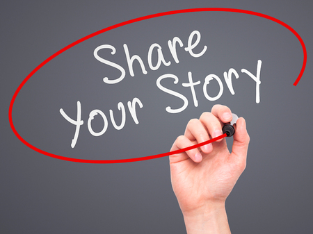 narrate: Man Hand writing Share Your Story with marker on transparent wipe board. Isolated on grey. Business, internet, technology concept.  Stock Photo
