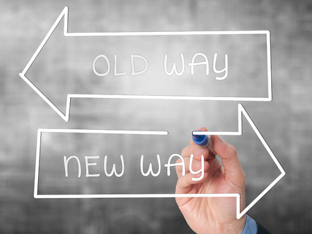 new way: Man Hand drawing Old Way or New Way concept with marker on visual screen. Stock Image