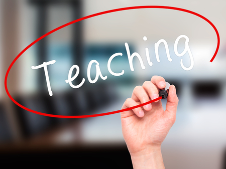 pedagogy: Man Hand writing Teaching with black marker on visual screen. Isolated on office. Business, technology, internet concept. Stock Image
