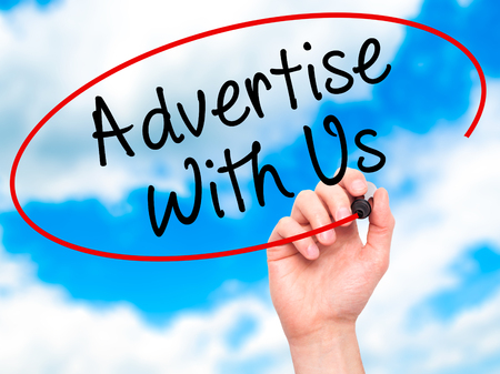 advertise with us: Man Hand writing Advertise With Us  with black marker on visual screen. Isolated on sky. Business, technology, internet concept. Stock Image