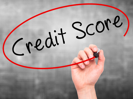 creditworthiness: Man Hand writing Credit Score black marker on visual screen. Isolated on grey. Business, technology, internet concept. Stock Image