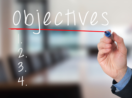 Man Hand writing Objectives to do list with marker. Business, internet concept. stock Image