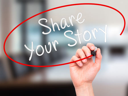 Man Hand writing Share Your Story with marker on transparent wipe board. Isolated on office. Business, internet, technology concept.  Stock Photo Stock Photo