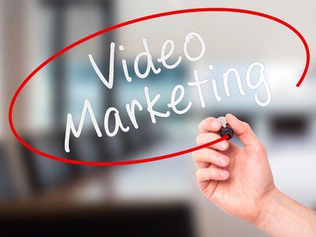 pr: Man Hand writing Video Marketing black marker on visual screen. Isolated on office. Business, technology, internet concept. Stock Image