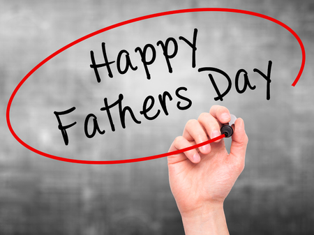 hearts day: Man Hand writing Happy Fathers Day with black marker on visual screen. Isolated on grey. Business, technology, internet concept. Stock Image Stock Photo