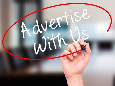 advertise with us: Man Hand writing Advertise With Us  with black marker on visual screen. Isolated on office. Business, technology, internet concept. Stock Image Stock Photo
