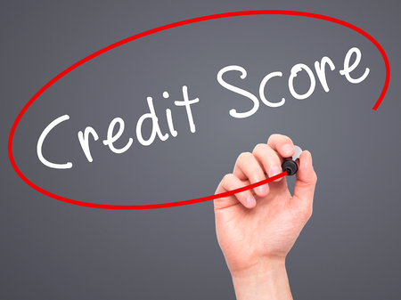 bank records: Man Hand writing Credit Score black marker on visual screen. Isolated on grey. Business, technology, internet concept. Stock Image