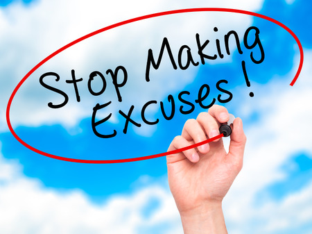 pardon: Man Hand writing Stop Making Excuses with black marker on visual screen. Isolated on sky. Business, technology, internet concept. Stock Image