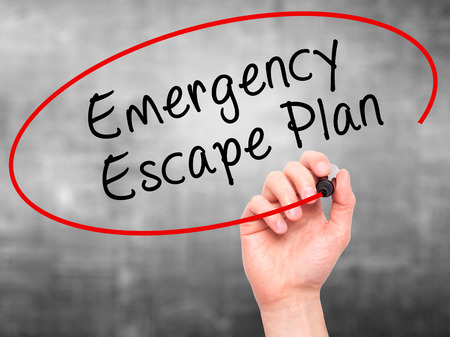 emergency plan: Man Hand writing Emergency Escape Plan with black marker on visual screen. Isolated on grey. Business, technology, internet concept. Stock Image Stock Photo